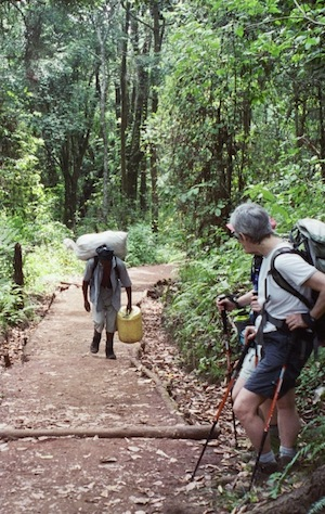 porter on Kilimanjaro - can adventure travel be too cheap
