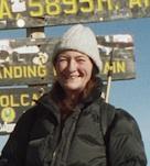 standing on top of Kilimanjaro