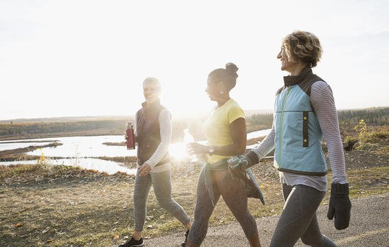 Three women walking to train for a hike